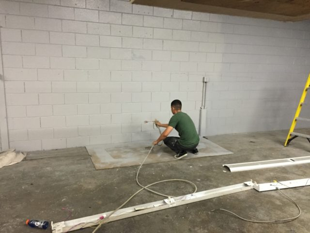 Prospect Marcus painting the clubhouse.